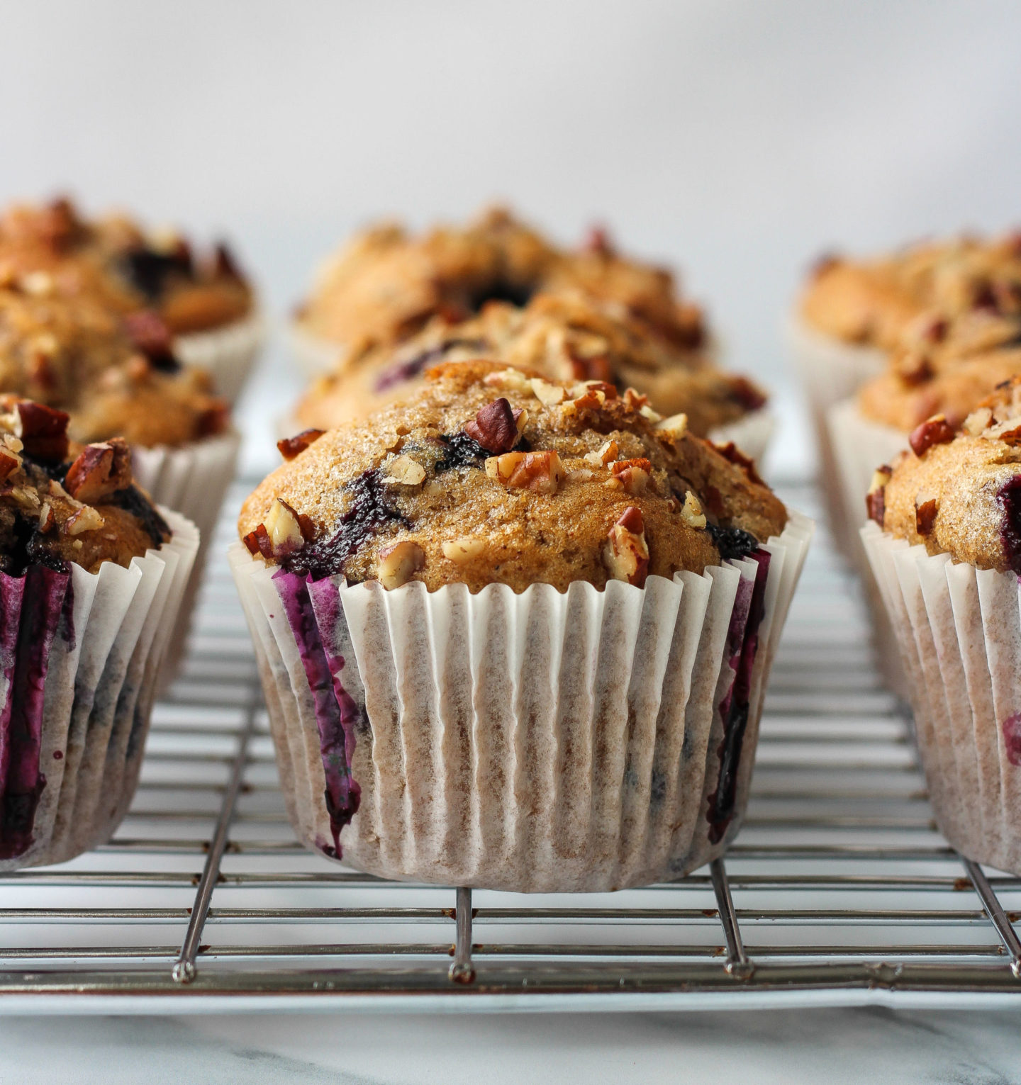 blueberry nut muffins on a wire rack