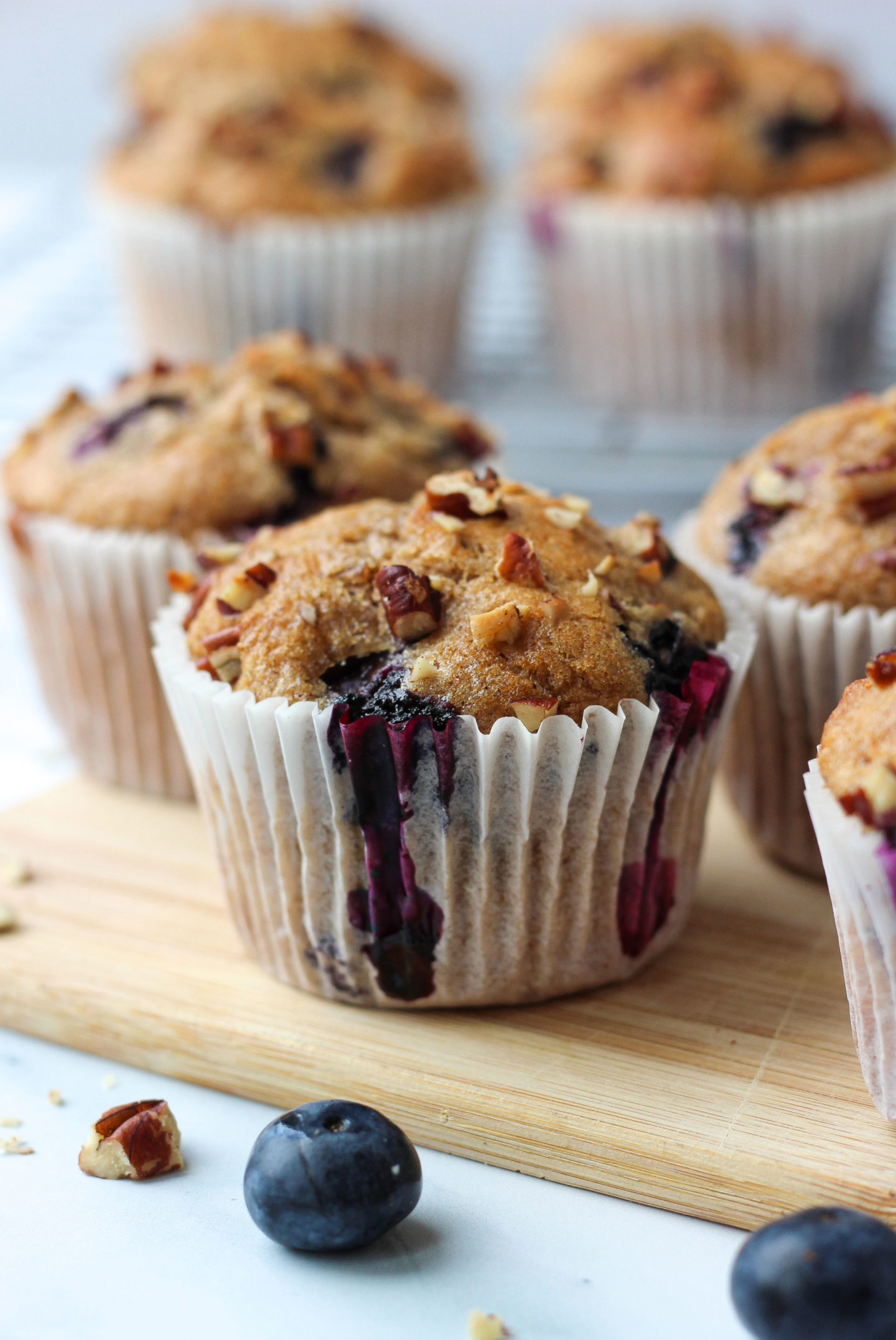close up of a blueberry nut muffin with others in background