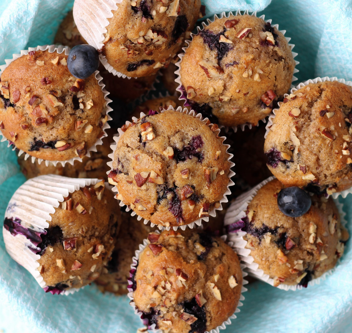 basket full of blueberry nut muffins