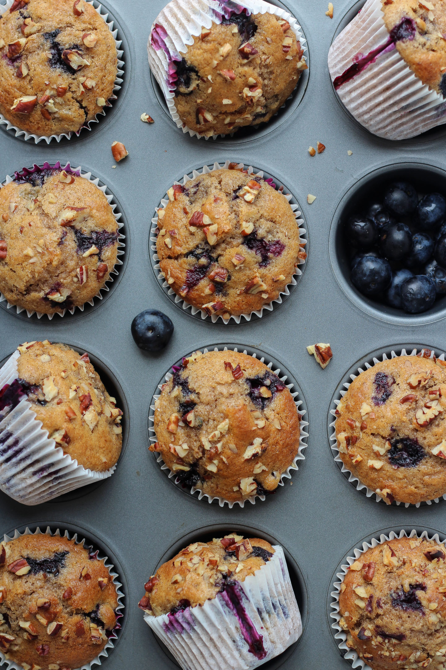 muffin tray filled with blueberry nut muffins