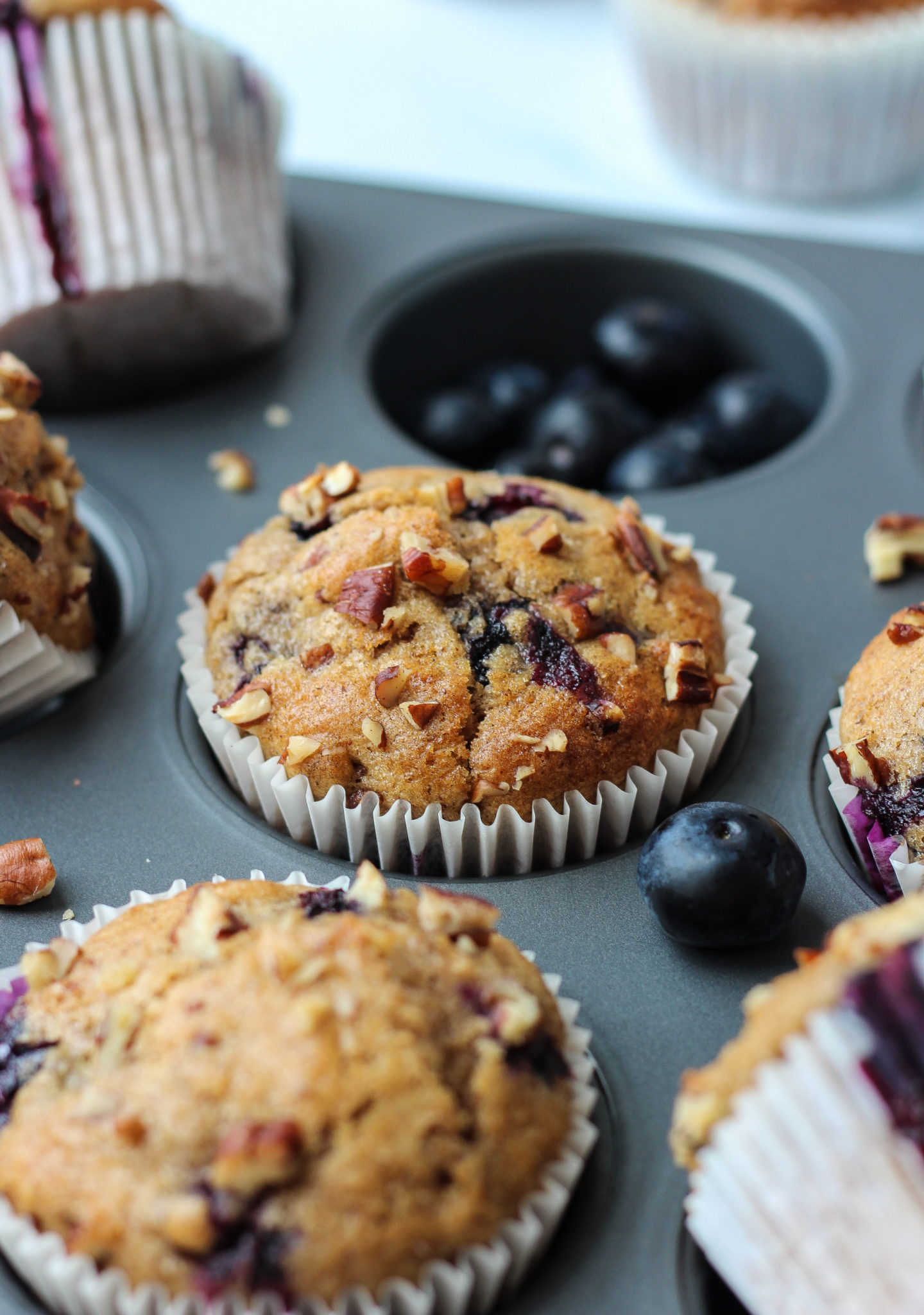 close up of blueberry nut muffin in a muffin tray