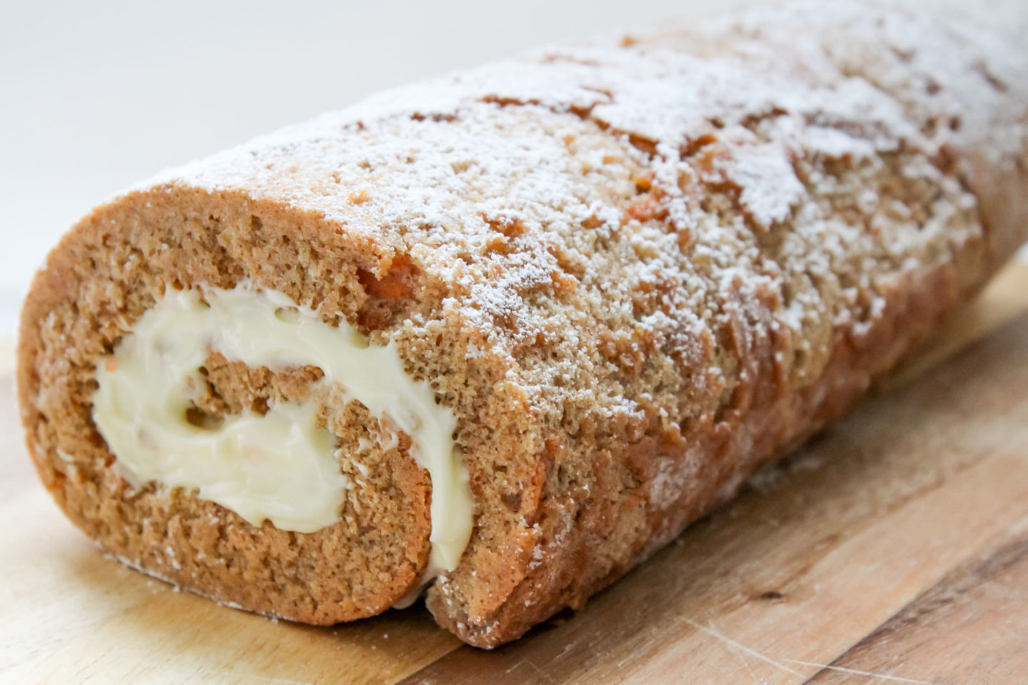 Carrot cake Swiss roll with cream cheese icing/frosting