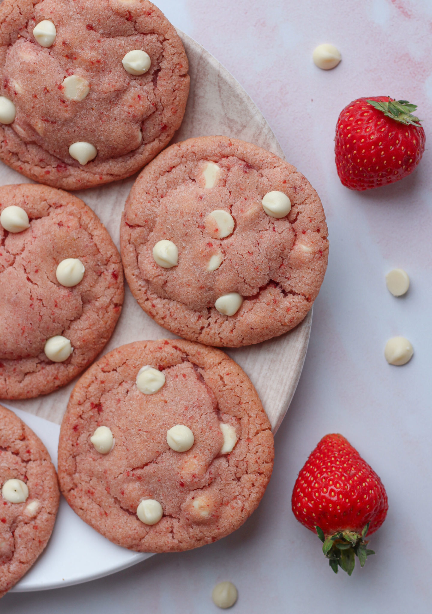 view from above of half a plate of strawberry white chocolate cookies