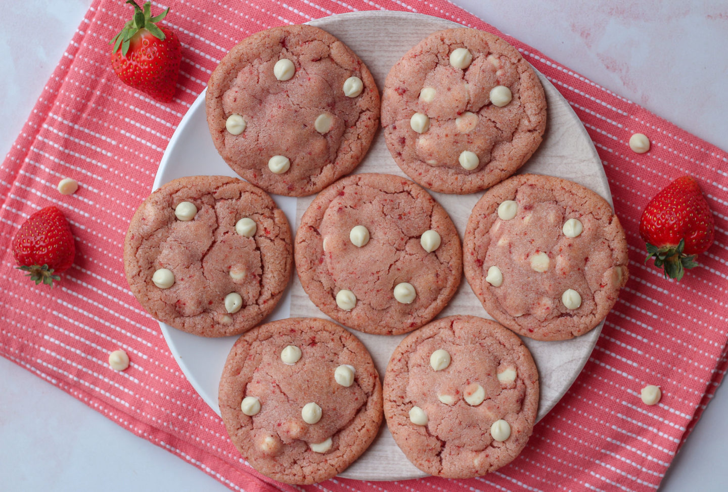 Small plate full of strawberry white chocolate cookies