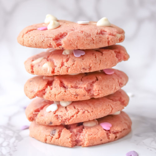 strawberry white chocolate cookies stacked on top of each other