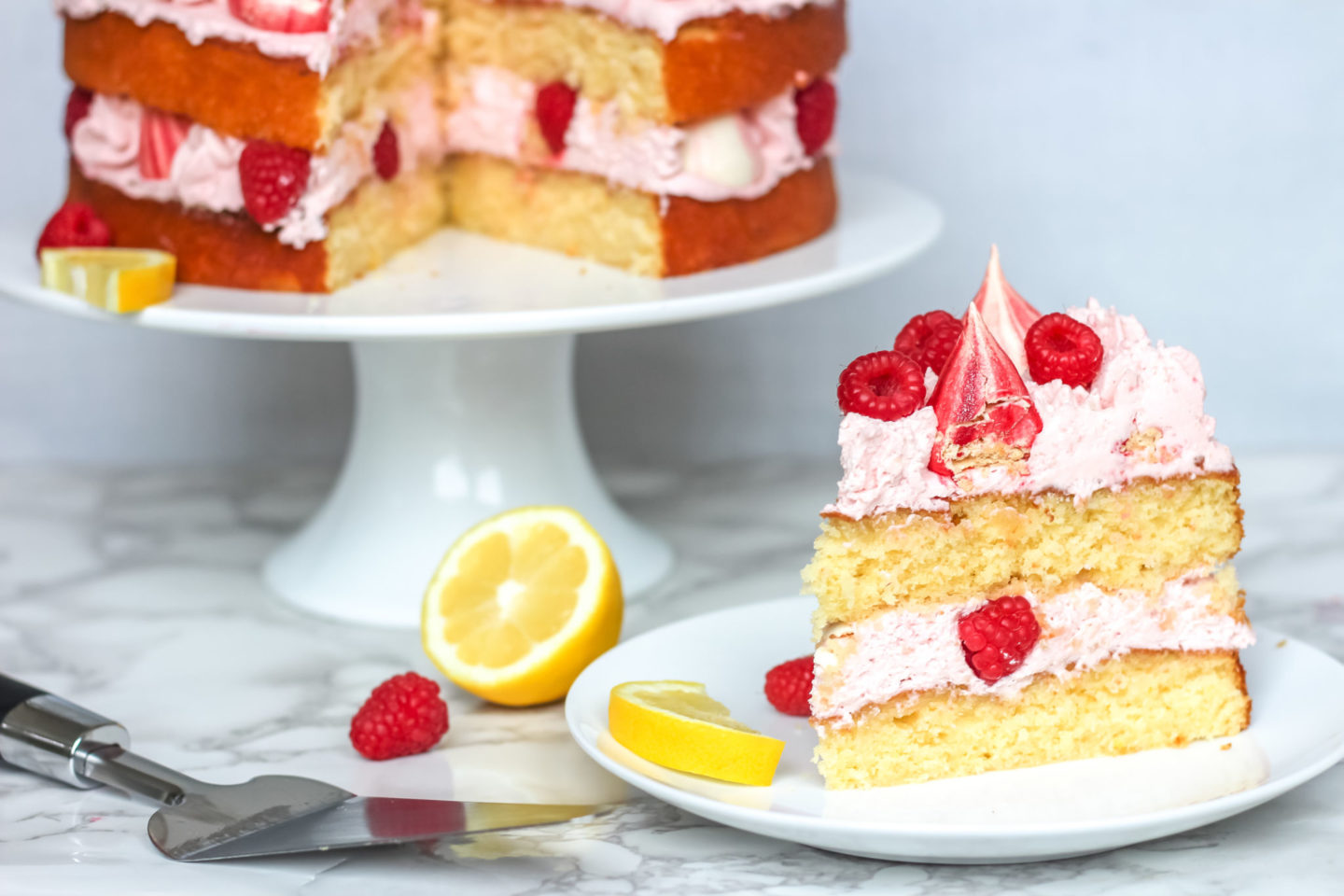 lemon raspberry cream cake with meringue kisses