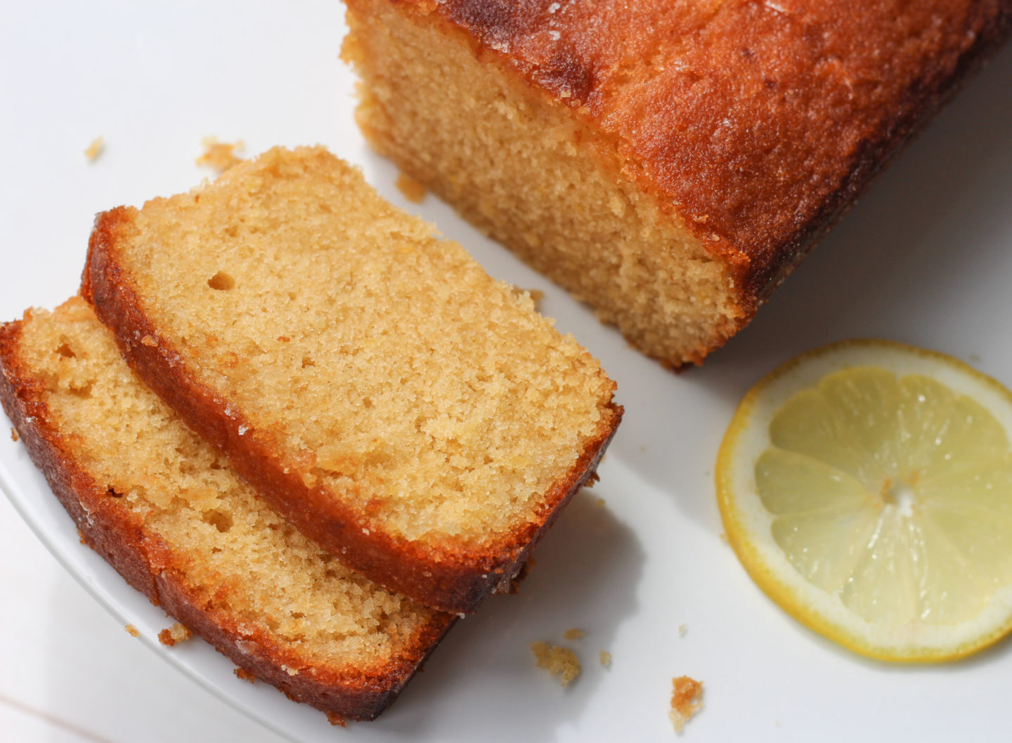 shot from above of sliced lemon drizzle loaf cake