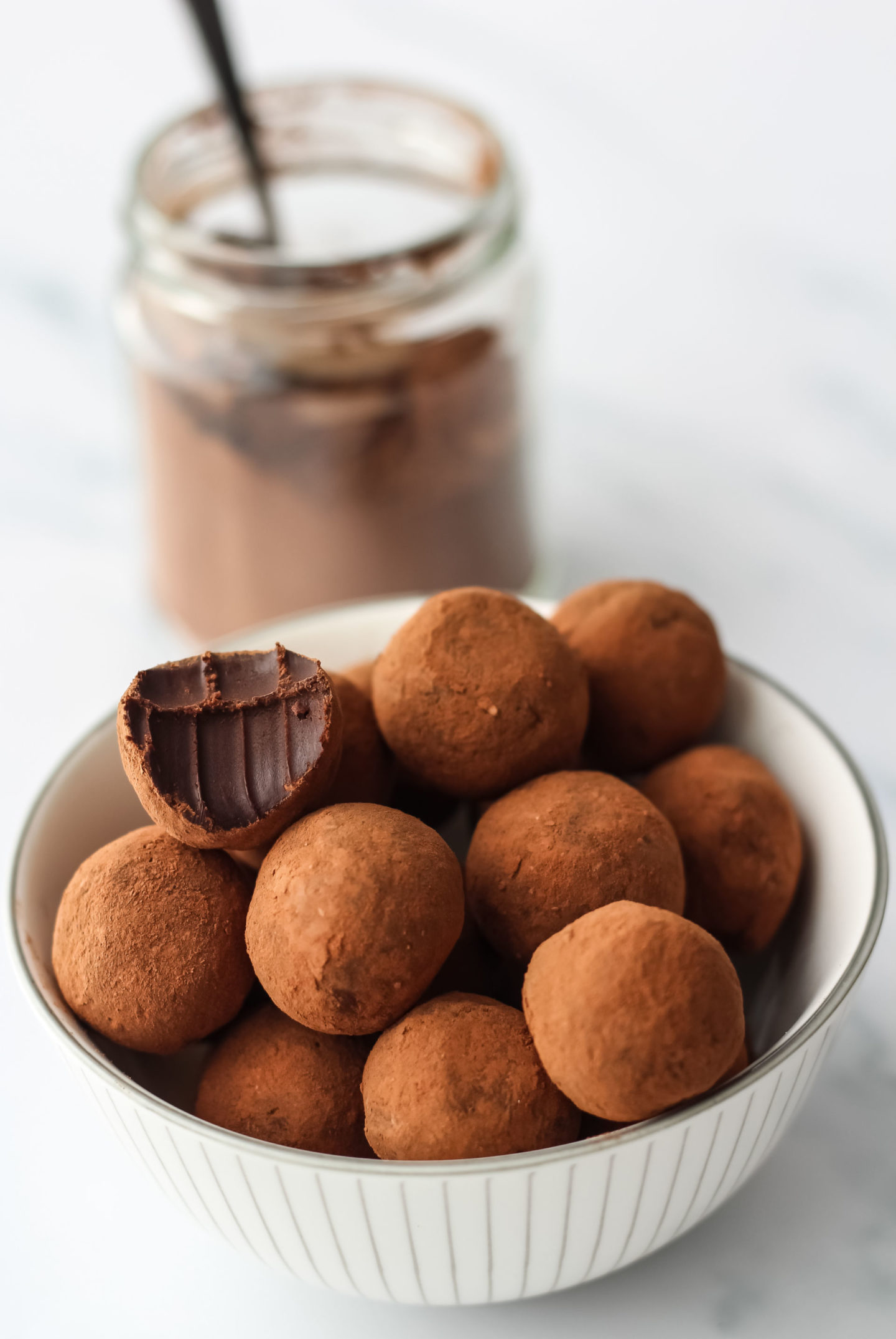 bowl of truffles with jar of cocoa powder