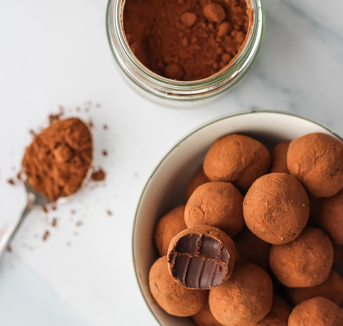 truffles, cocoa powder in jar and spoon of cocoa