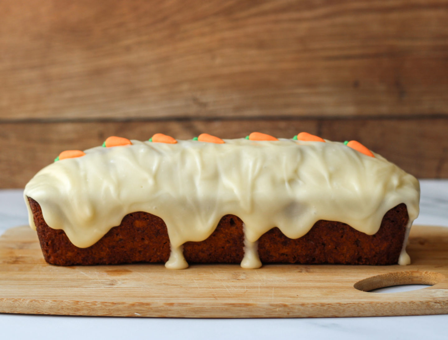 side view of loaf cake with drip icing