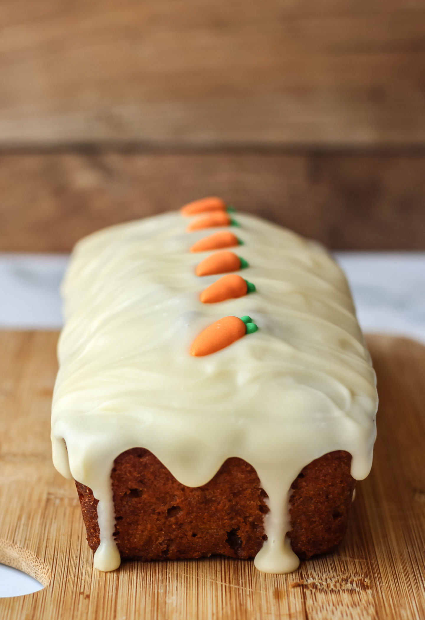 close up of loaf cake with icing drip