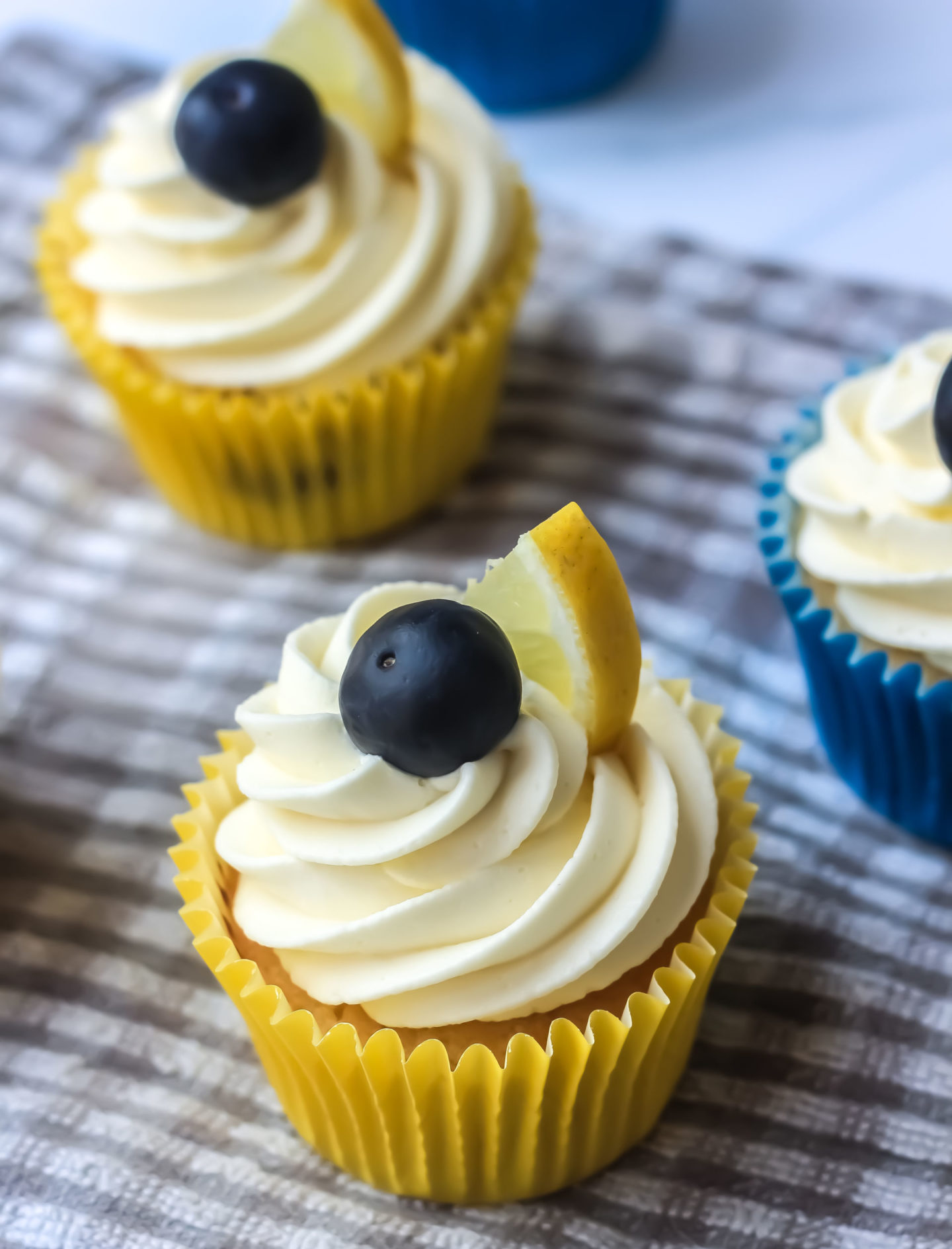 close up of frosted lemon and blueberry cupcake