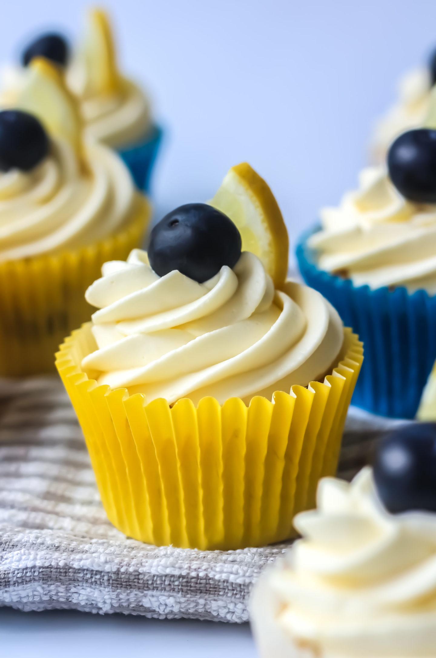 close up of iced lemon blueberry cupcake