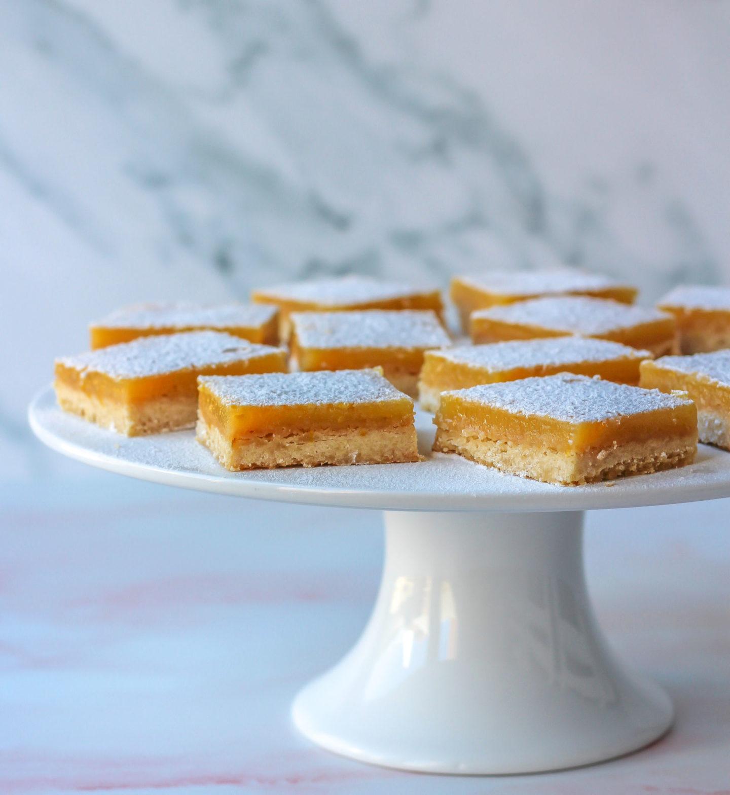 cake stand of lemon bars