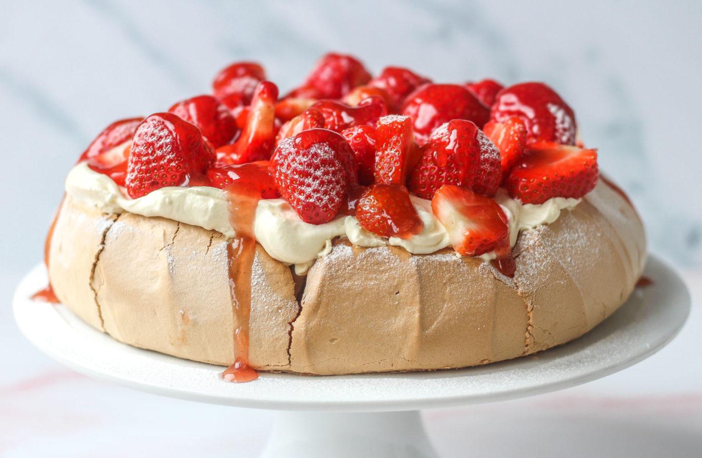 strawberry pavlova on cake stand
