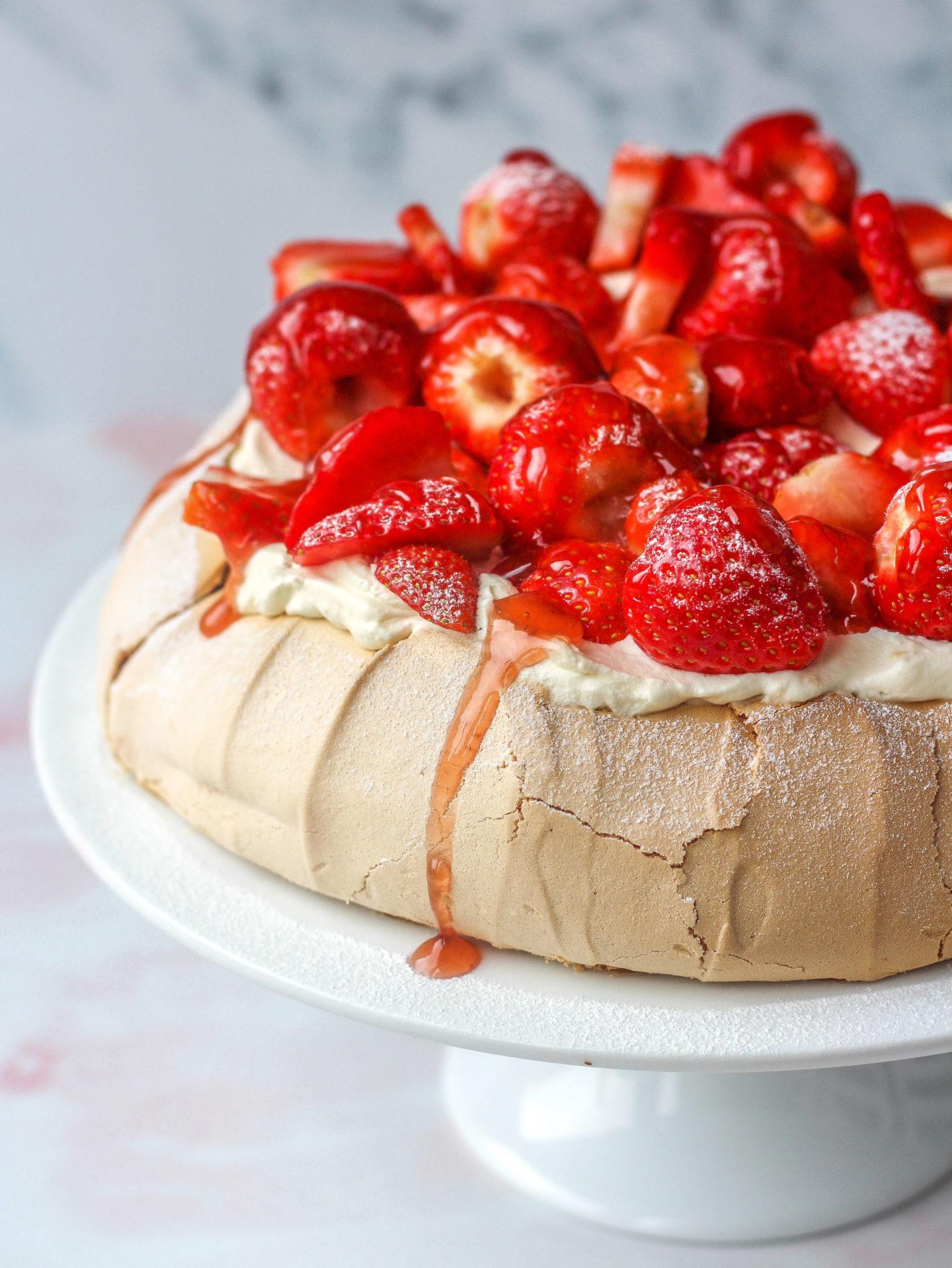 close up of strawberry pavlova with strawberry glaze