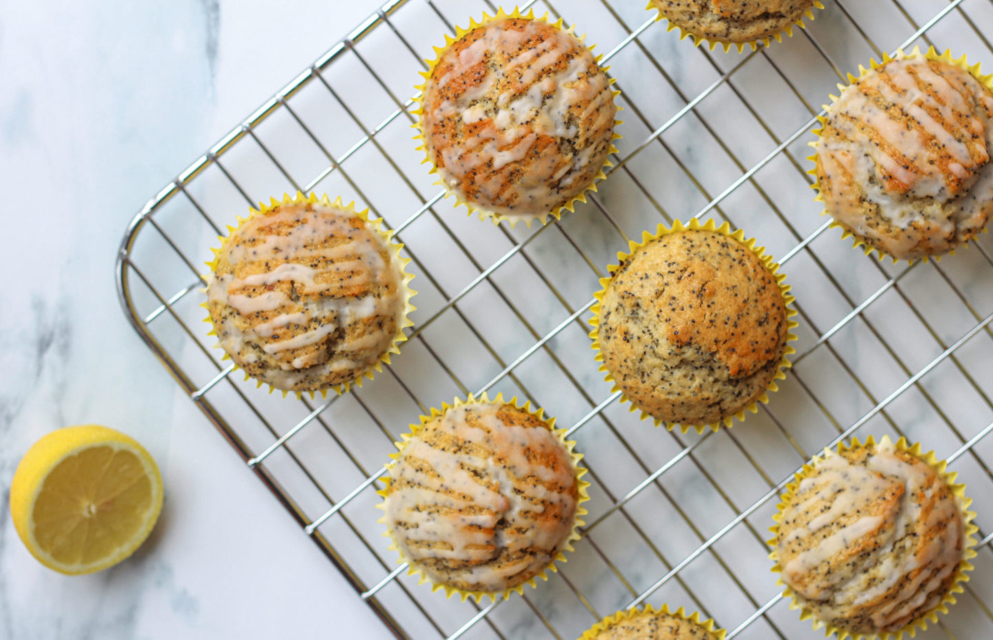 view from above of several lemon poppy seed muffins on wire rack