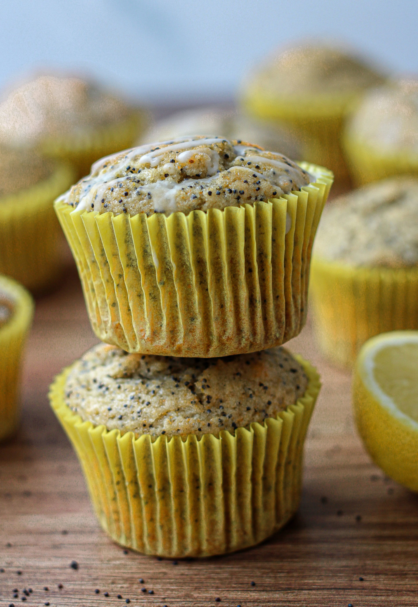 two lemon poppy seed muffins stacked together