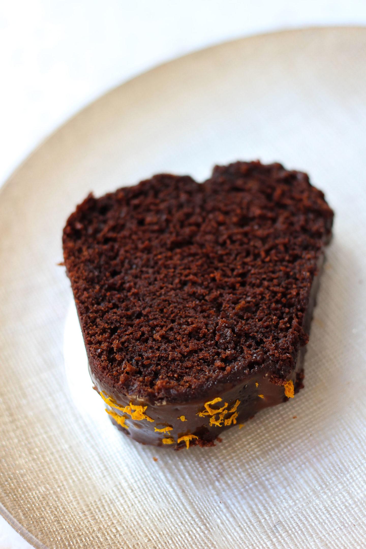 Close up of slice of chocolate orange Bundt cake on a plate