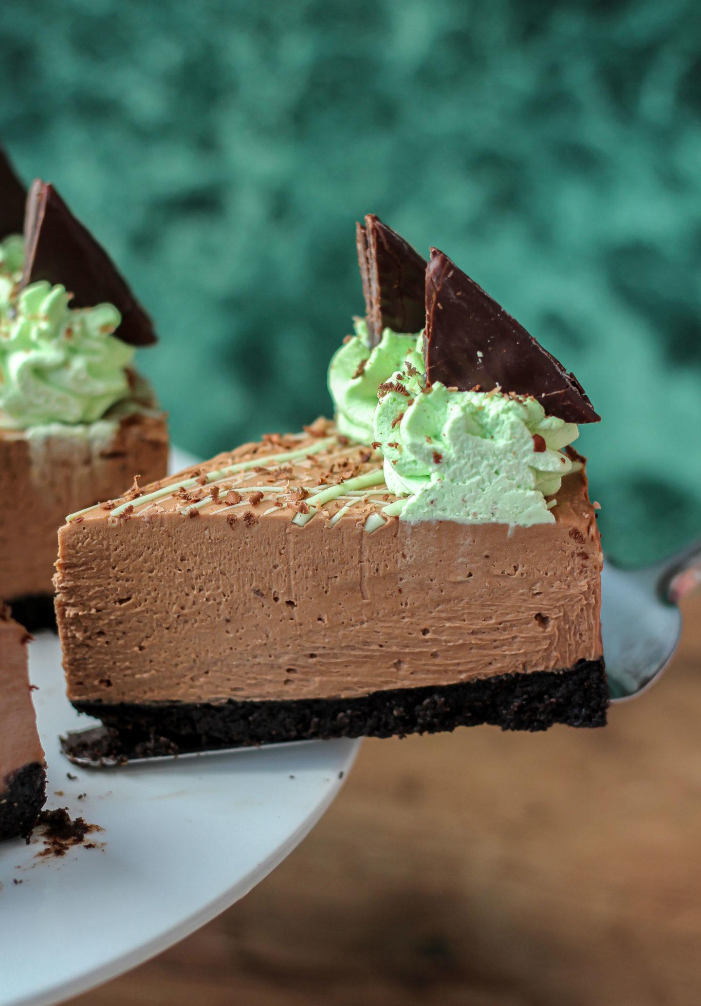 Close up of individual slice of no-bake mint chocolate cheesecake