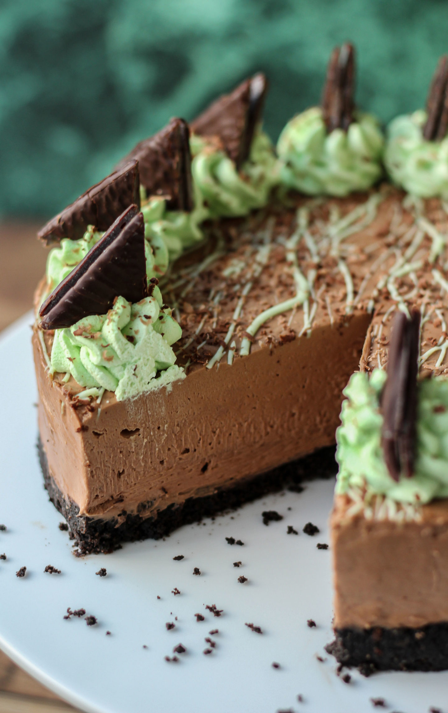 Close up showing inside of no-bake mint chocolate cheesecake