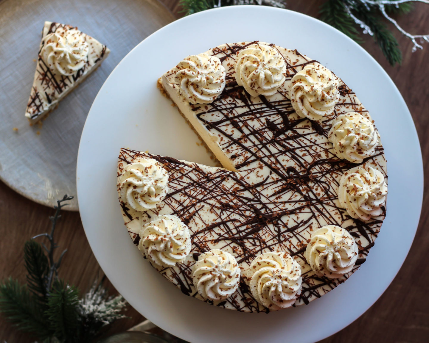 View from above of no-bake Baileys cheesecake with a slice taken from it