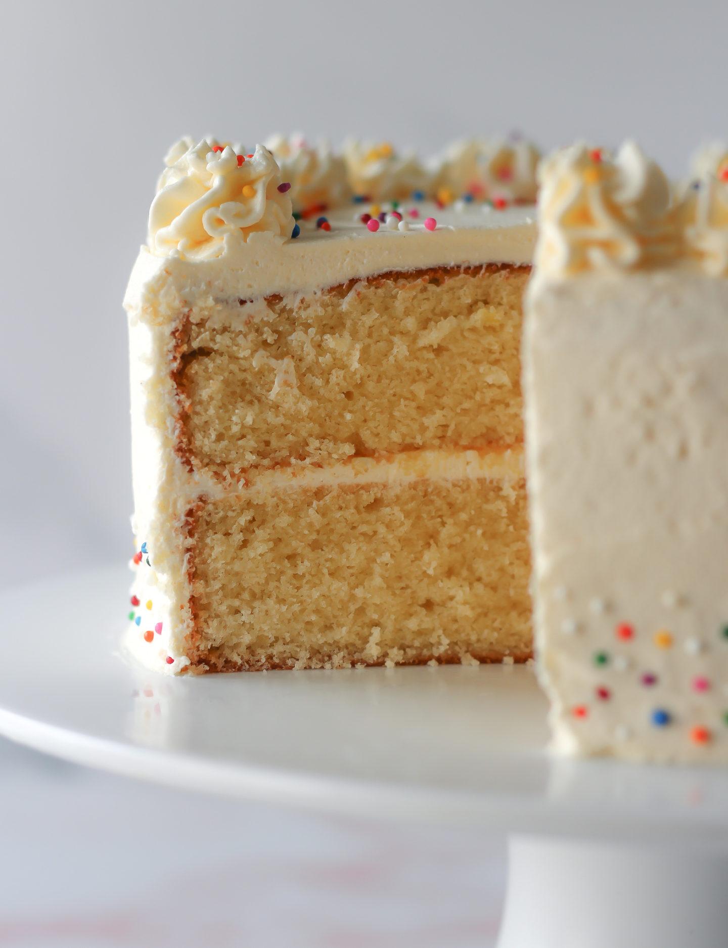 close up inside sliced vanilla layer cake with vanilla buttercream