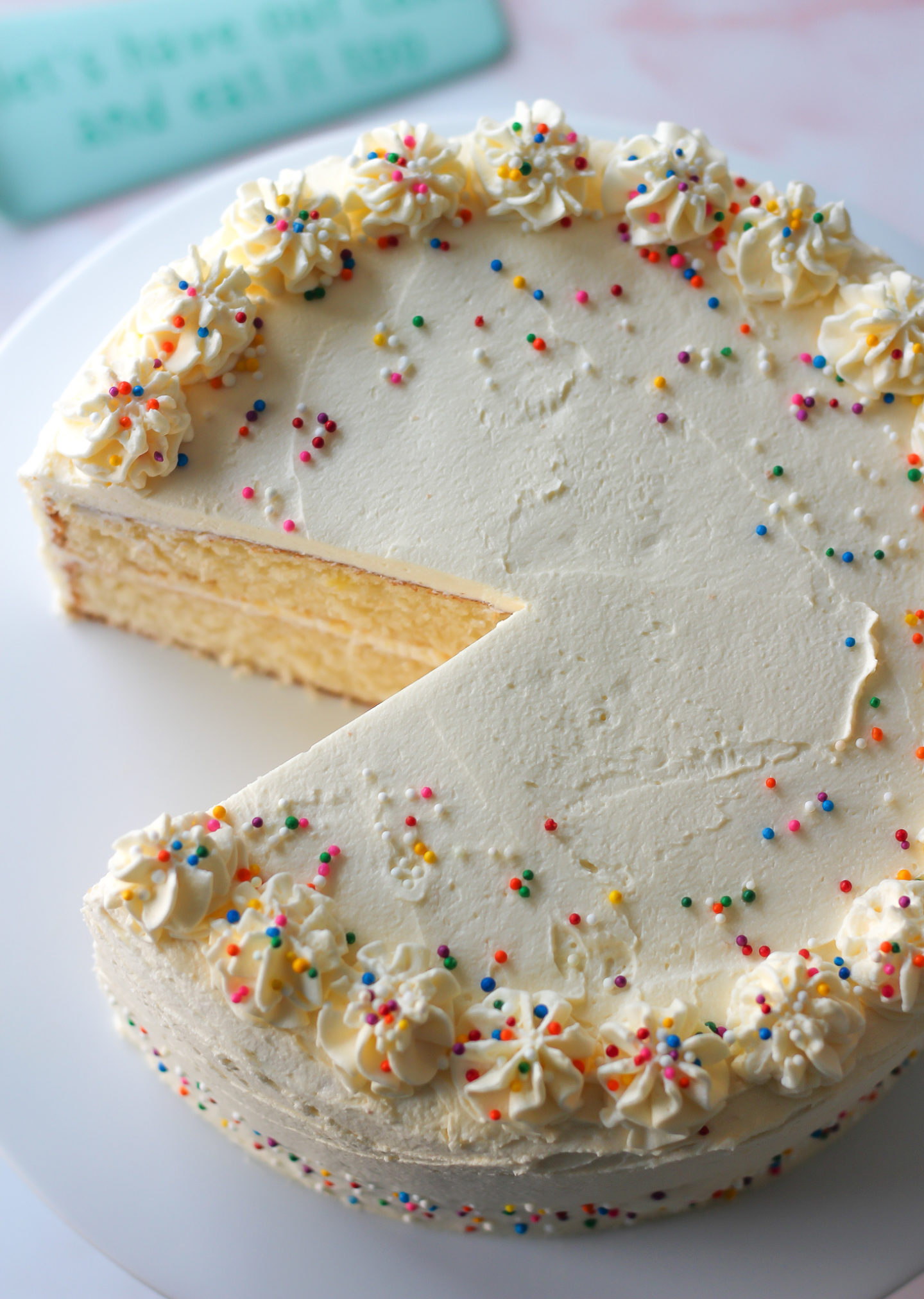 view from above of vanilla layer cake with vanilla buttercream