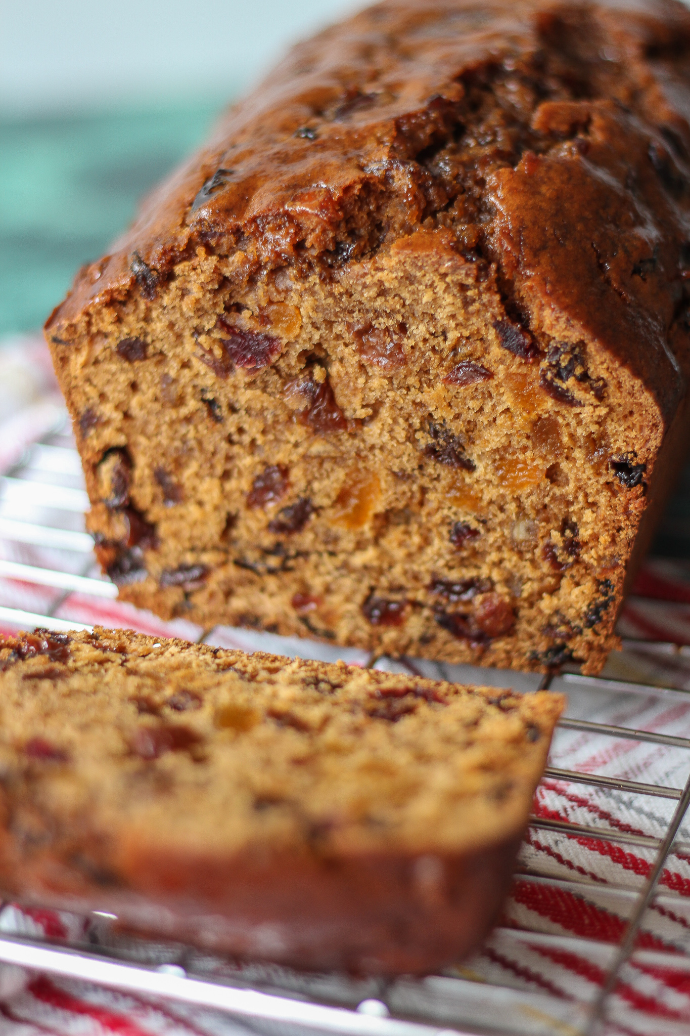 close up inside Bara Brith on wire rack, with slice in front