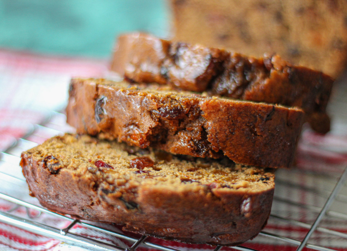 three slices of Bara Brith stacked on top of each other on wire rack