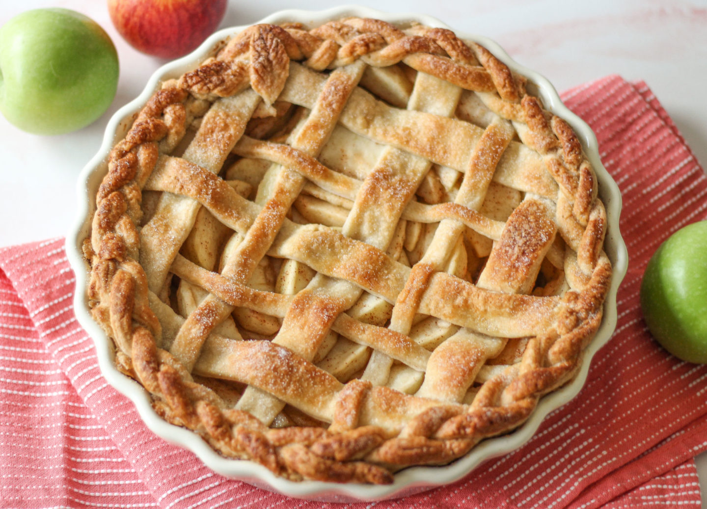 view from above of whole uncut lattice apple pie