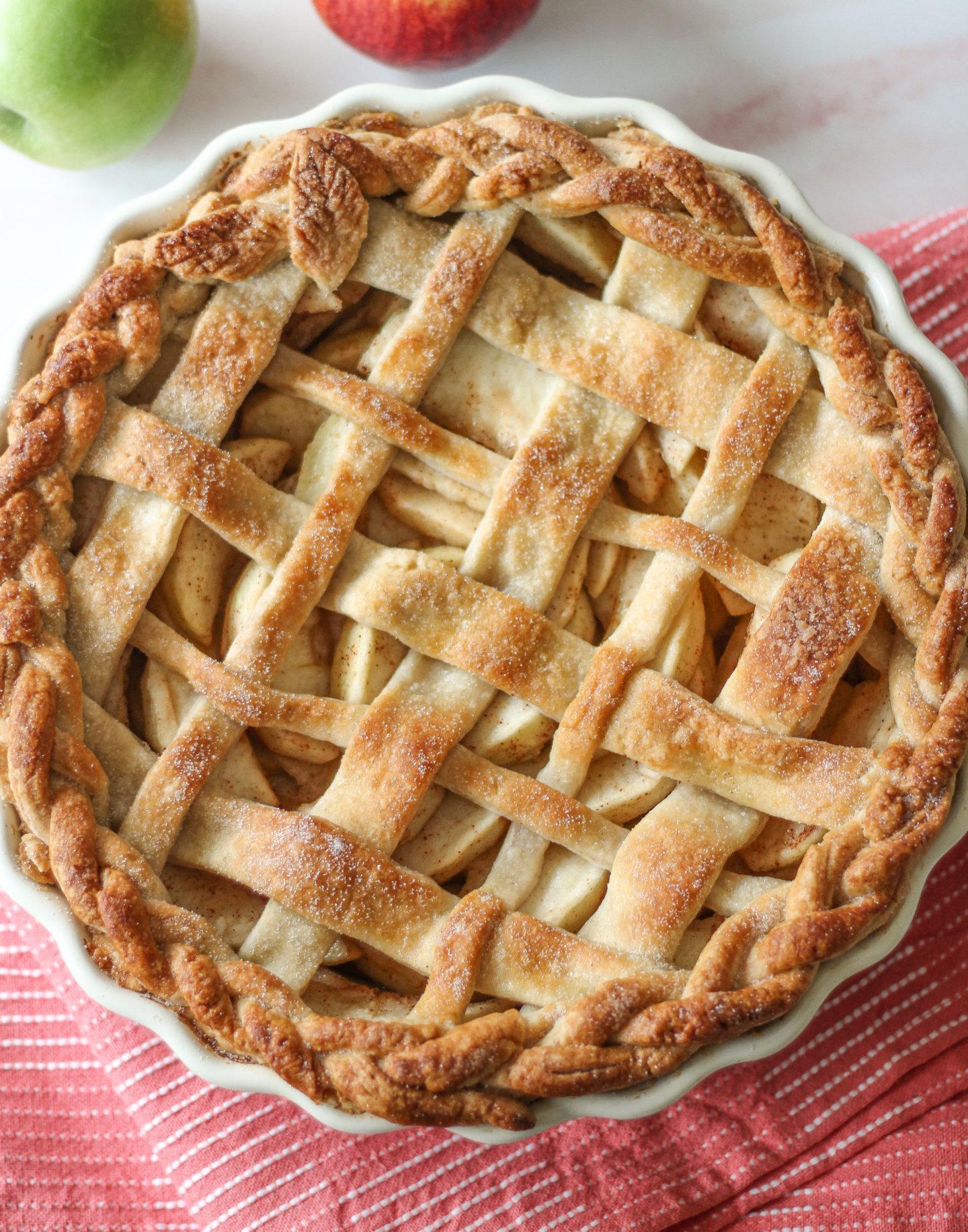 overhead view of whole uncut lattice apple pie