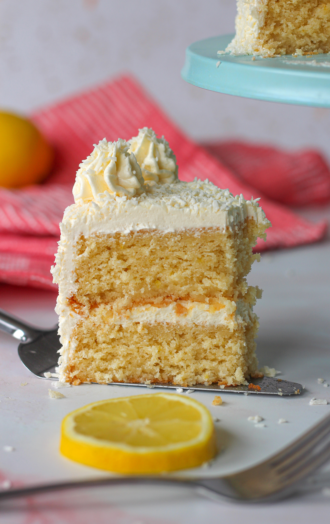 close up of a slice of lemon coconut layer cake