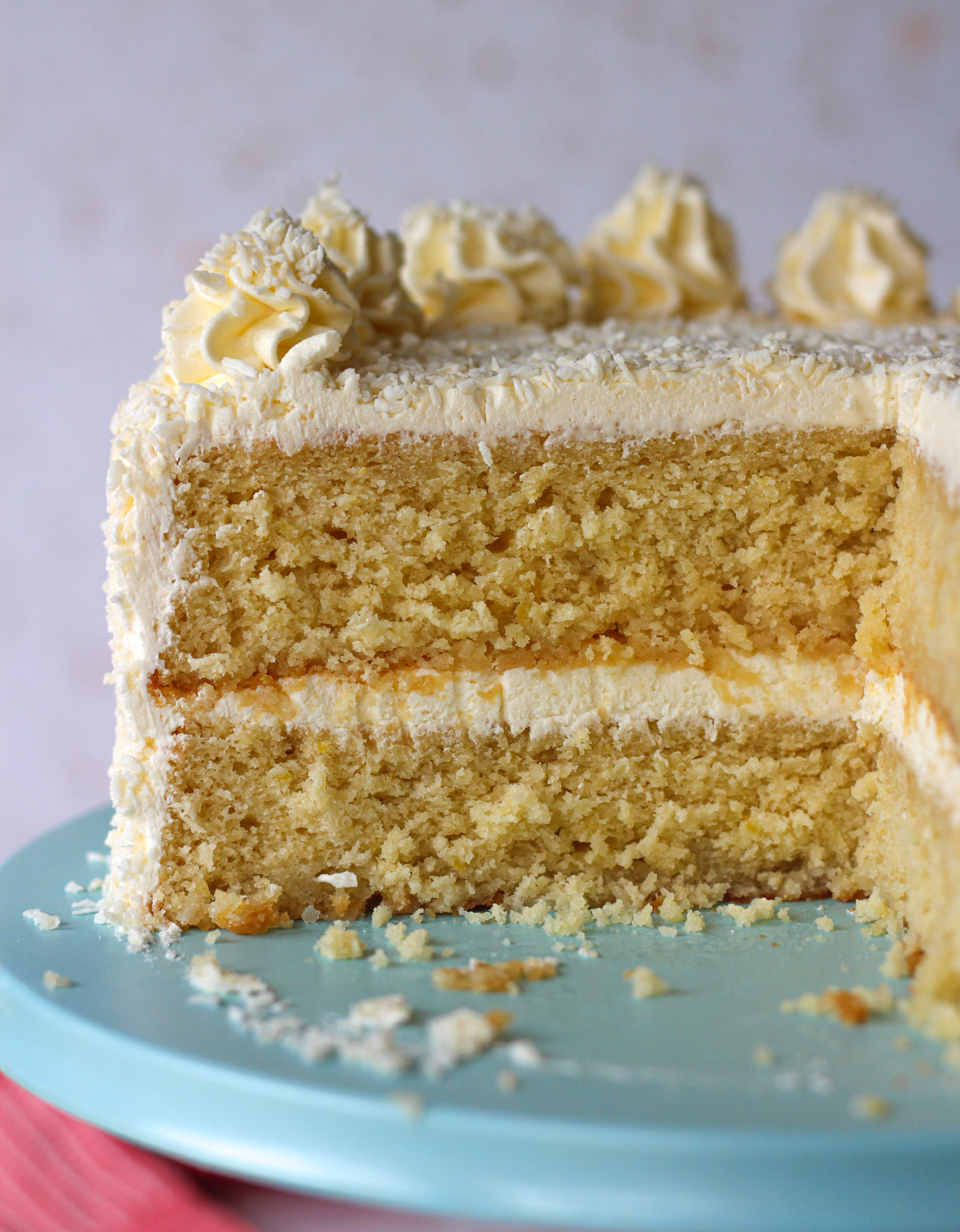 close up of inside of sliced lemon coconut layer cake, showing the cake texture