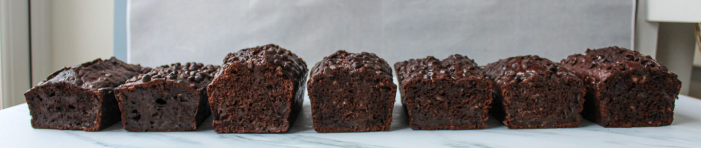 recipe development progress showing the first seven test loaf cakes
