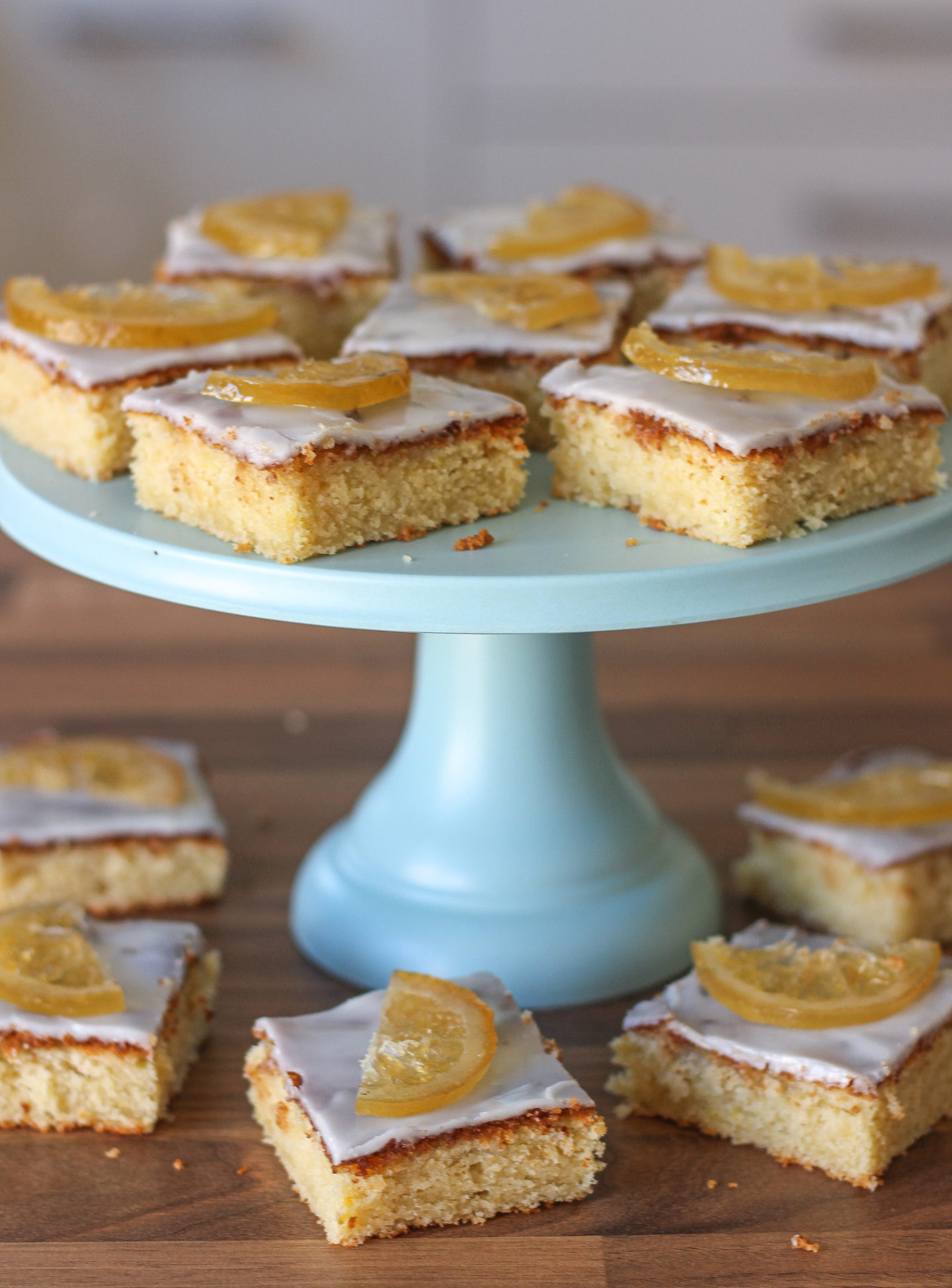 several of the bake off box: lemony lemon slices on and around a blue cake stand