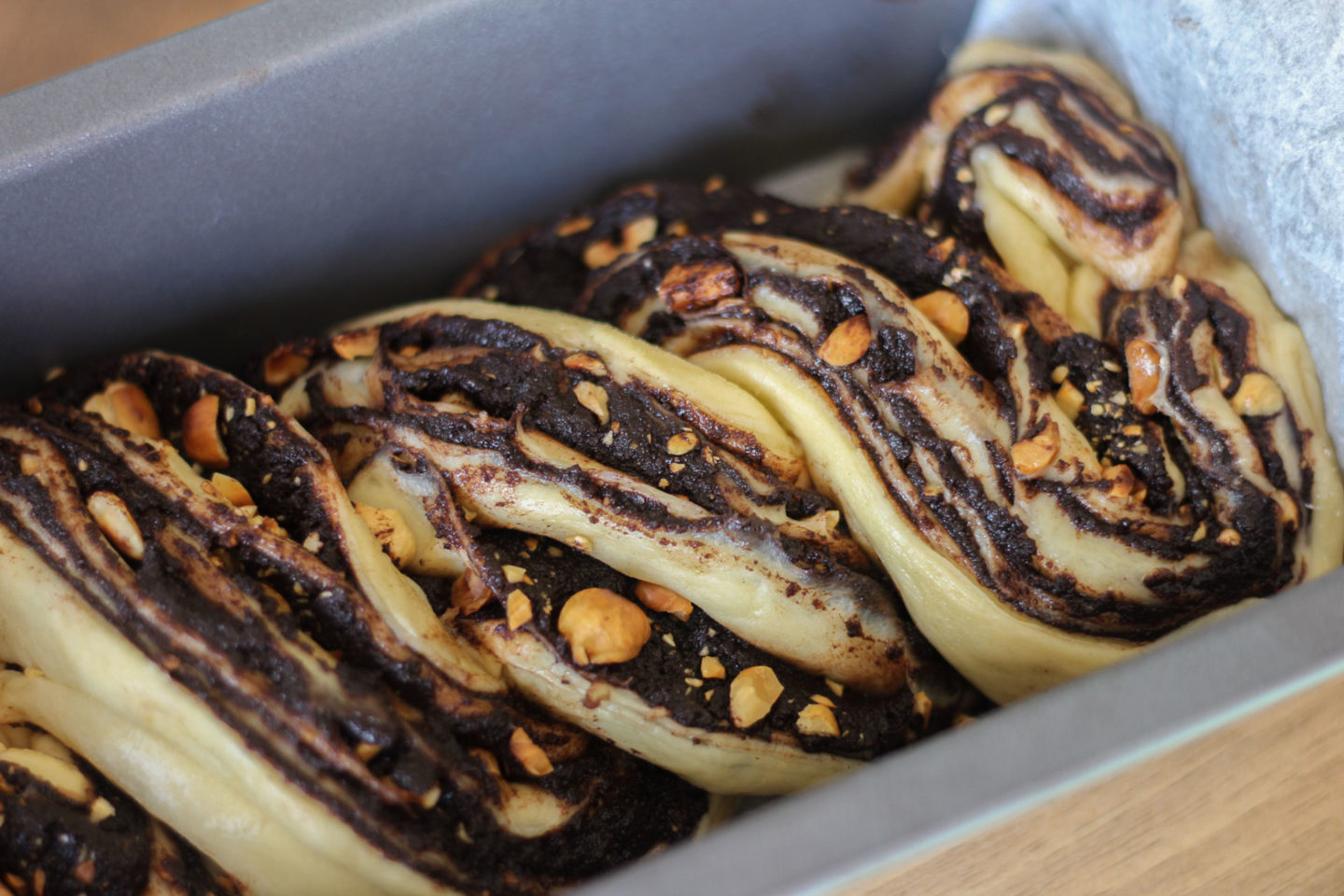 unbaked chocolate and hazelnut babka in loaf tin before the final proof