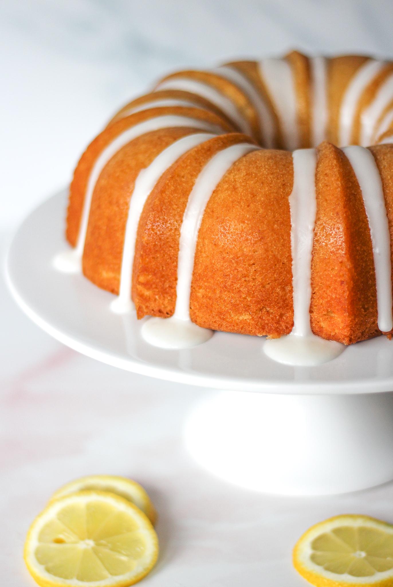 Close up of half of a lemon drizzle bundt cake