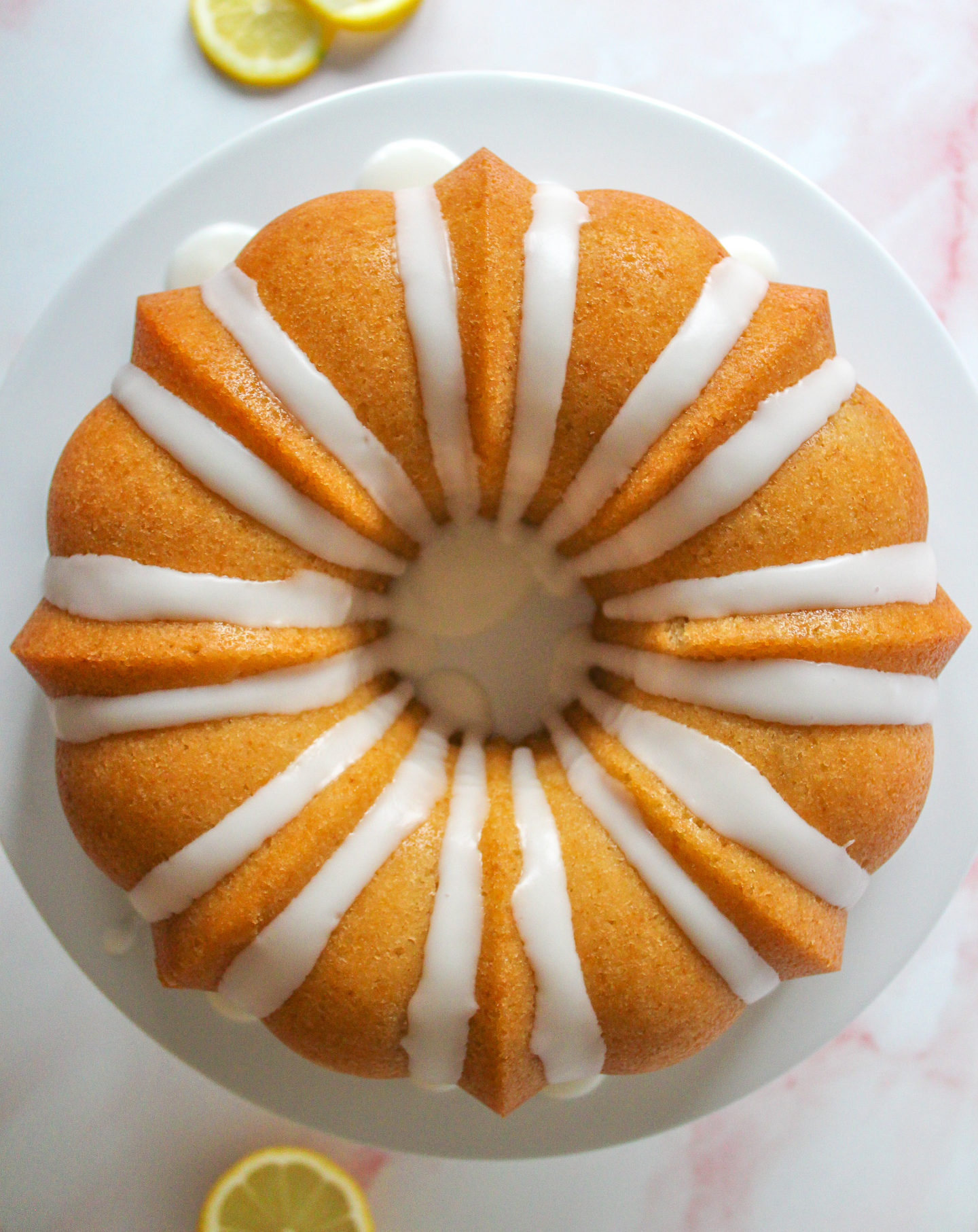 View from above of glazed lemon drizzle bundt cake
