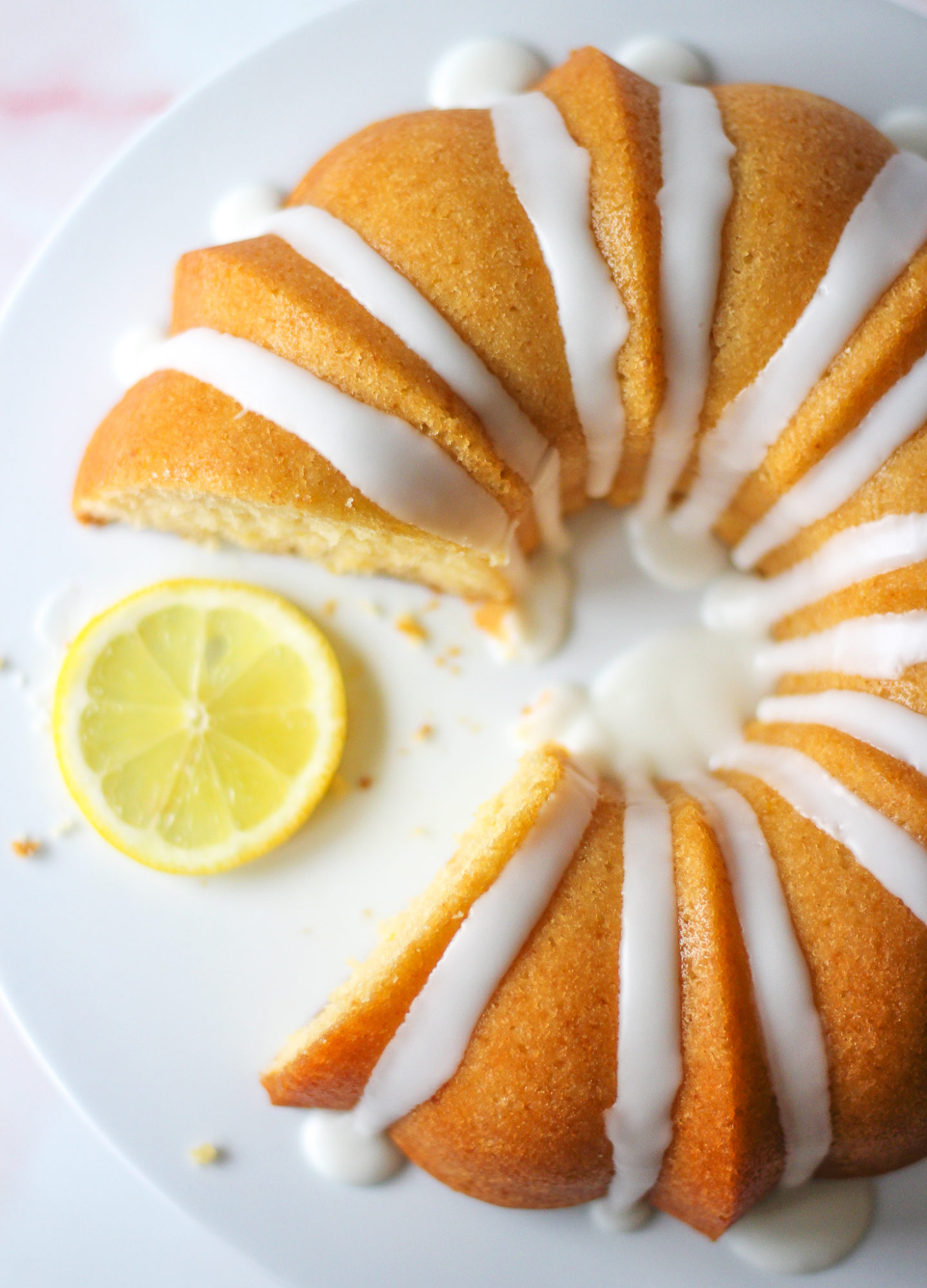 view from above of a sliced lemon drizzle bundt cake